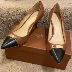 Coach Saddle & Black pumps with gold hardware.
